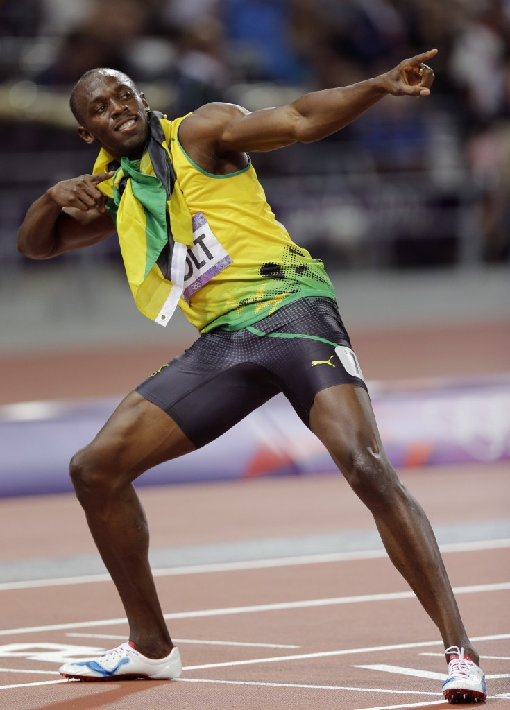 Jamaica's Usain Bolt celebrates winning gold in the men's 200-meter final during the athletics in the Olympic Stadium at the 2012 Summer Olympics, London, Thursday, Aug. 9, 2012. (AP Photo/David J. Phillip)